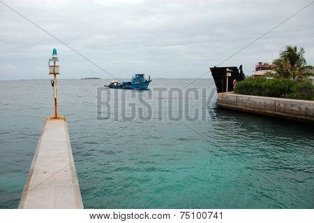 Blue ship at Bandos Island port gate Maldives poster