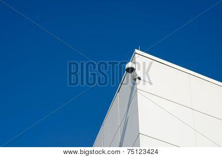 Security Camera Against Blue Sky