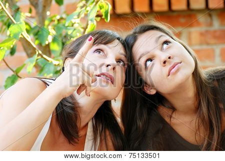 Mother And Daughter Looking Up