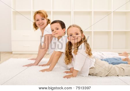 Happy Healthy Family Making Gym Exercises