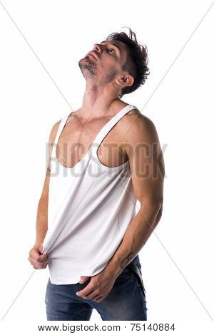 Young Athletic Man Pulling Down Tanktop