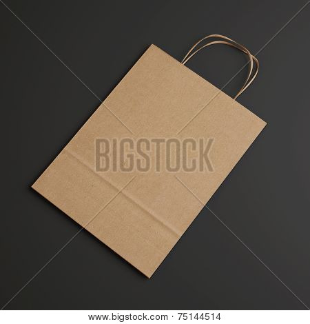 Brown Paper Bag With Handles On Dark Background