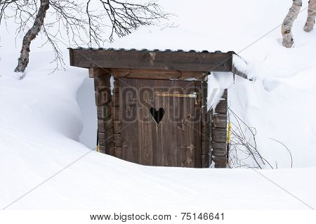 Wooden and secret place in deep snow.