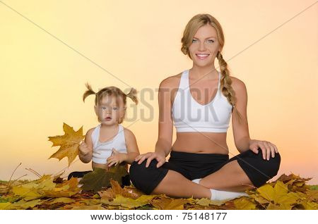 Woman And Child Doing Yoga In Fall