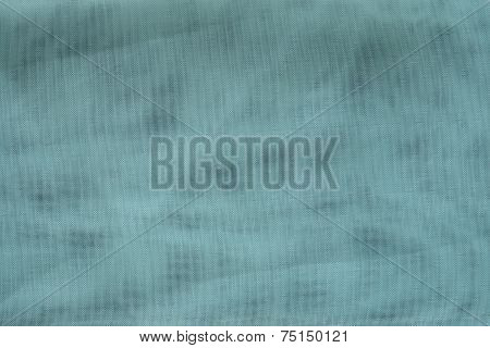 the textured background of turquoise color with tone spots from synthetic fabric in a grid with small cells poster