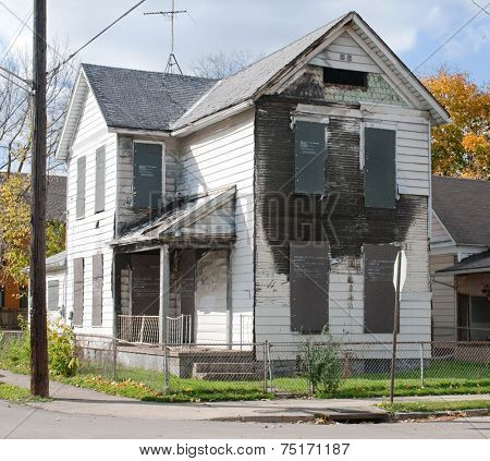 Burned Out & Boarded Up House