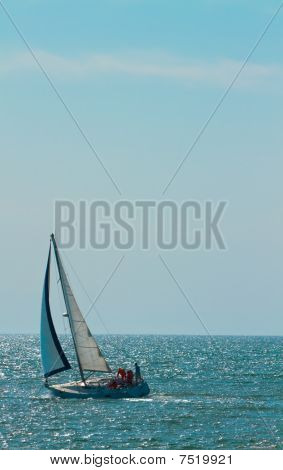 Solo Sailboat On Ocean
