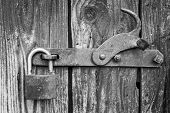 Old padlock on a black and white picture poster