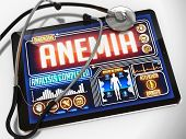 Medical Tablet with the Diagnosis of Anemia on the Display and a Black Stethoscope on White Background. poster