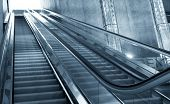 Moving escalator in the business center of a city poster
