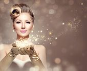 Holiday Retro Woman with magic in her hand. Beauty Fashion Christmas Vintage Style Lady with Beautiful Luxury Hairstyle, makeup, accessories. Golden Silk Gloves and dress  poster