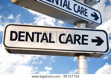 Dental Care direction sign on sky background