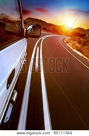 Road trip, car on the highway, road trip on sunset, journey and freedom travel, slow motion photo