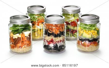 vegetable salad in glass jar on white background