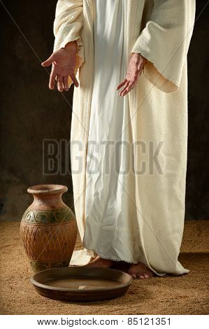 Jesus standing before a jar of water inside a precarious building