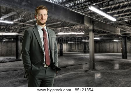Young businessman smiling inside a construction site