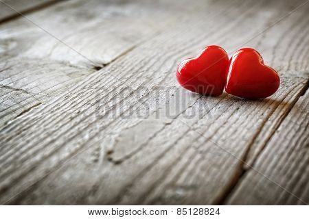Two hearts on a wooden background concept for love, dating and romance with copyspace poster