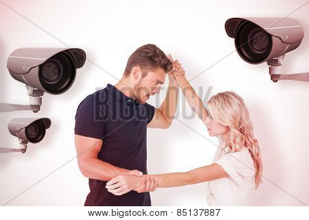 Angry man overpowering his girlfriend against cctv camera