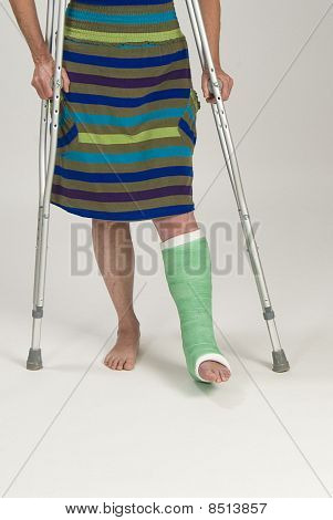 Woman with cast and crutches.