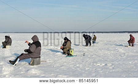 Winter Fishermen On River Ice