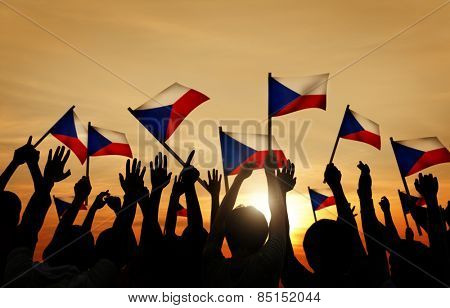 Silhouettes of People Holding the Flag of Philippines Concept