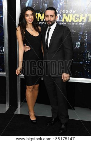 NEW YORK-MAR 9: Director Jaume Collet-Serra (R) and actress Isabel Burr attend the premiere of