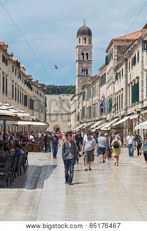 DUBROVNIK, CROATIA - MAY 27, 2014: Tourists walking on Stradun. Stradun is 300 meters long main pedestrian street in Dubrovnik.