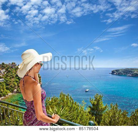 Beautiful woman looking on Valtos beach near Parga town of Syvota area in Greece.