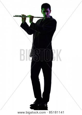 one caucasian man  playing transverse flute player in studio silhouette isolated on white background