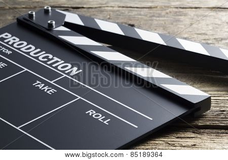 Movie clapper on wood background