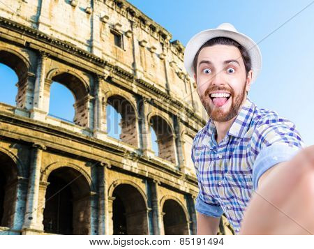 Happy young man taking a selfie photo in Rome, Italy