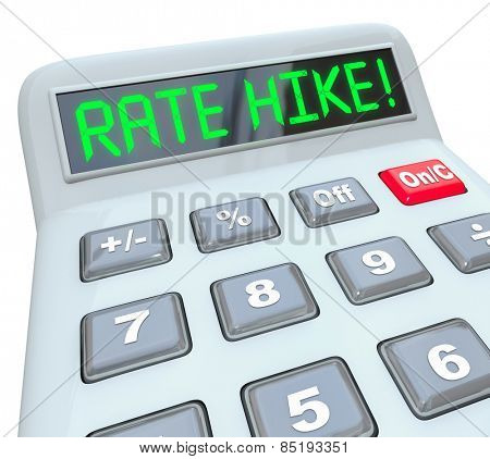 Rate Hike words in green letters on a calculator display to illustrate increased interest costs in borrowing money in a loan, mortgage or financing