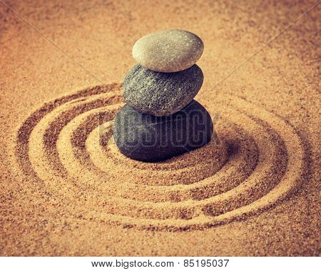 Vintage retro effect filtered hipster style image of Japanese Zen stone garden - relaxation, meditation, simplicity and balance concept  - pebbles and raked sand tranquil calm scene poster