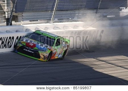 Las Vegas, NV - Mar 07, 2015:  David Ragan (18) hits the wall and damages his M&M's Toyota during the the Kobalt 400 at Las Vegas Motor Speedway in Las Vegas, NV.