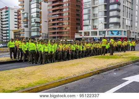 Policemen waiting for Pope Francis Popemobile motorcade coming as his first official visit  to Quito