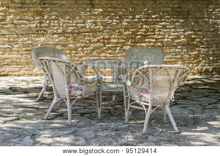 Outdoor Terrace At Courtyard With Limestone Wall, Cane Chair Furniture