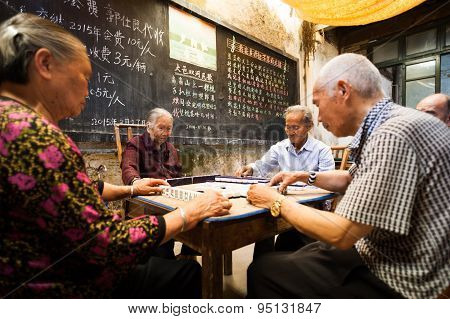 Old Chinese People Playing Mahjong