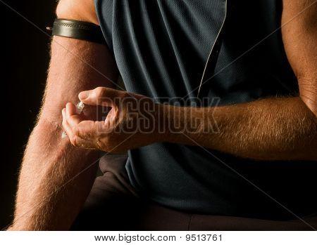 man shooting heroin