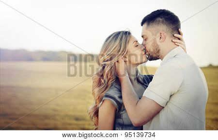 Stunning Sensual Young Couple In Love Kissing At The Sunset In Summer Field