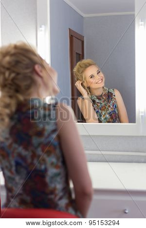beautiful cute sexy happy girl with dyed hair krasivay and primp in the mirror