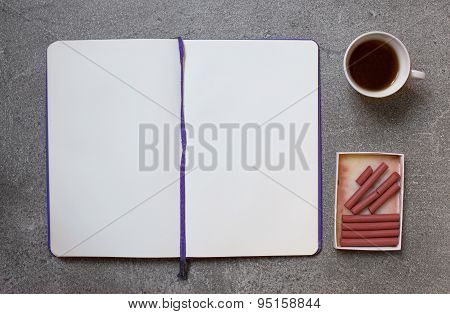 Sanguine For Sketching On Gray Background With Cup Of Coffee