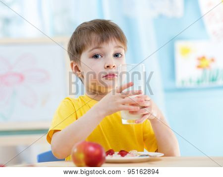 Child Boy With A Glass Of Fresh Buttermilk