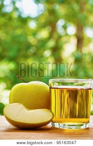 Apple, lobule and glass on the table