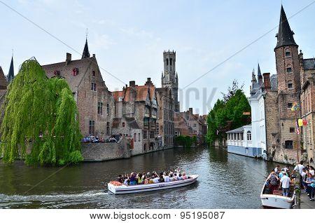 Bruges, Belgium - May 11, 2015: Tourist Visit Rozenhoedkaai (the Quai Of The Rosary) In Bruges