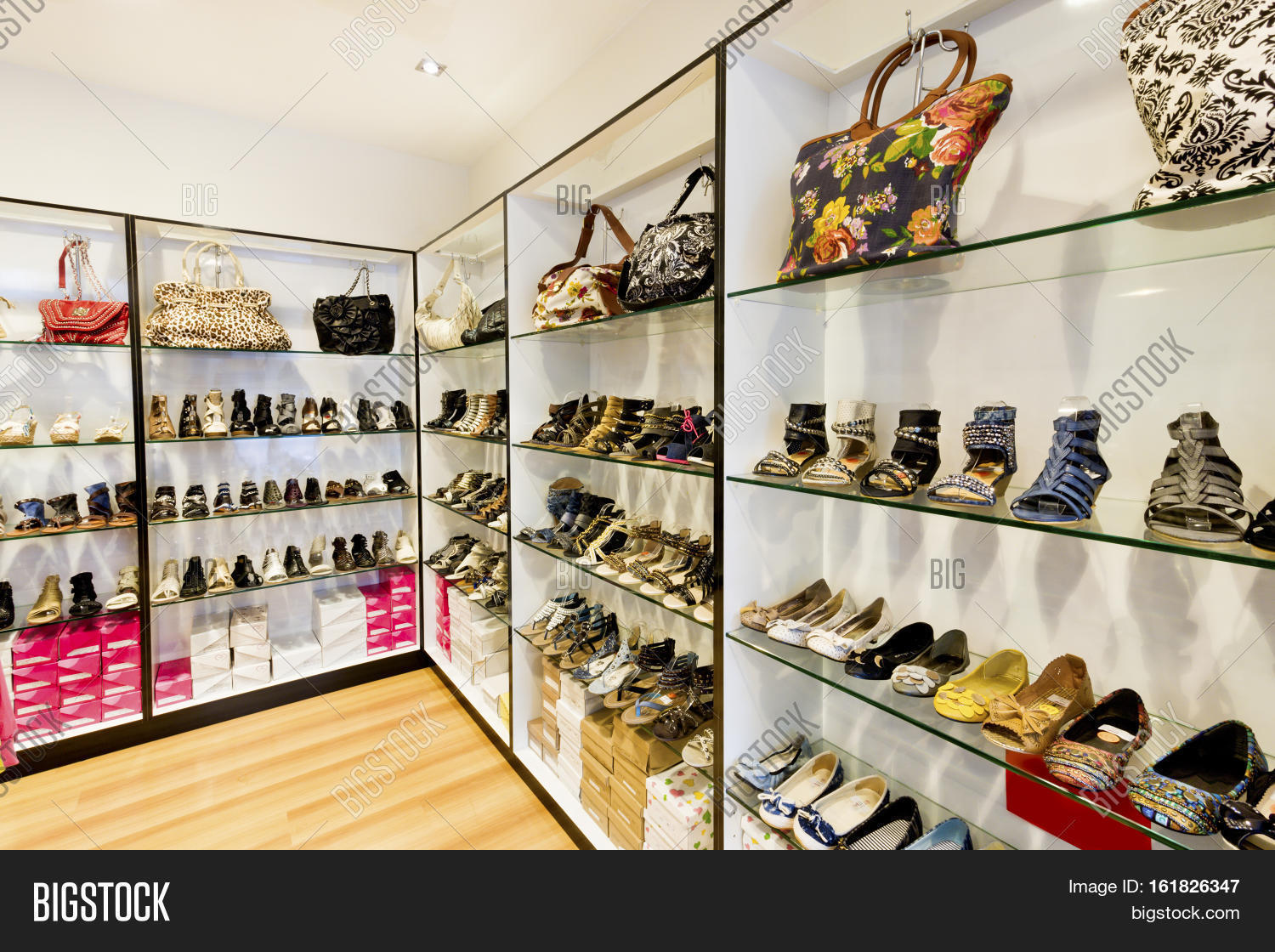 51515c2cb34f Modern shoe shop with ladies and gents items in leather beside bags sandals  shoes boots with