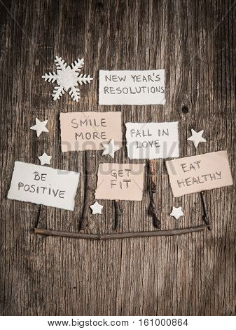 New Year's Resolutions On Rustic Wooden Backgroun