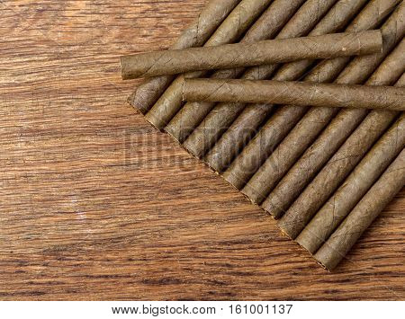 the Cigarillo on wooden background close up