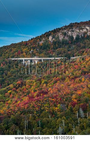 Leaves Changing Color Around Linn Cove Viaduct in Fall Vertical