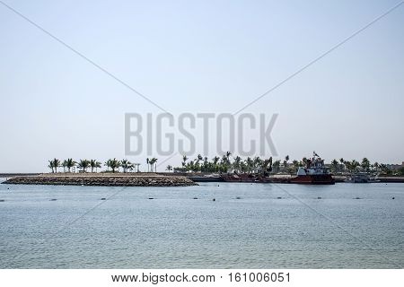 Boat dredger creating land coastline in Souly Bay Salalah Oman 2