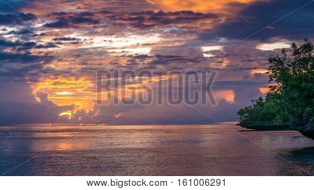 Beautiful Sunset near Kordiris Homestay, Gam Island, West Papuan, Raja Ampat. Indonesia
